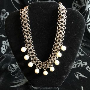 Silver toned chain necklace with hanging pearls